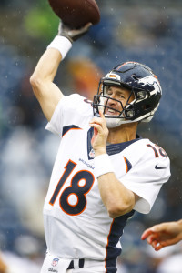 Aug 14, 2015; Seattle, WA, USA; Denver Broncos quarterback Peyton Manning (18) participates in warmups before a preseason NFL football game against the Seattle Seahawks at CenturyLink Field. Mandatory Credit: Joe Nicholson-USA TODAY Sports