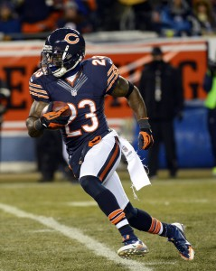 Dec 9, 2013; Chicago, IL, USA; Chicago Bears wide receiver Devin Hester (23) returns a kick off against the Dallas Cowboys during the first quarter at Soldier Field. Mandatory Credit: Mike DiNovo-USA TODAY Sports